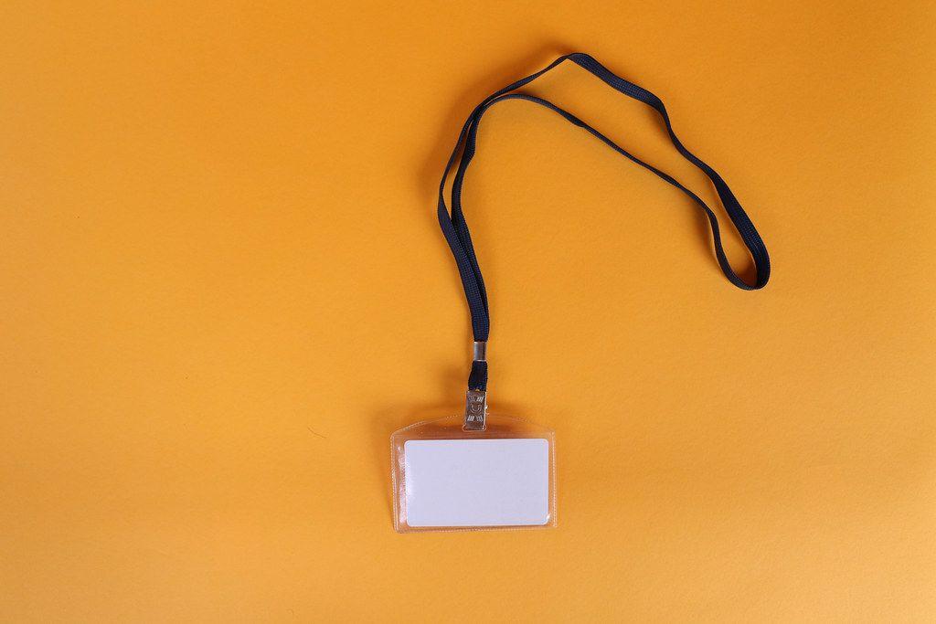 Empty name tag on orange background