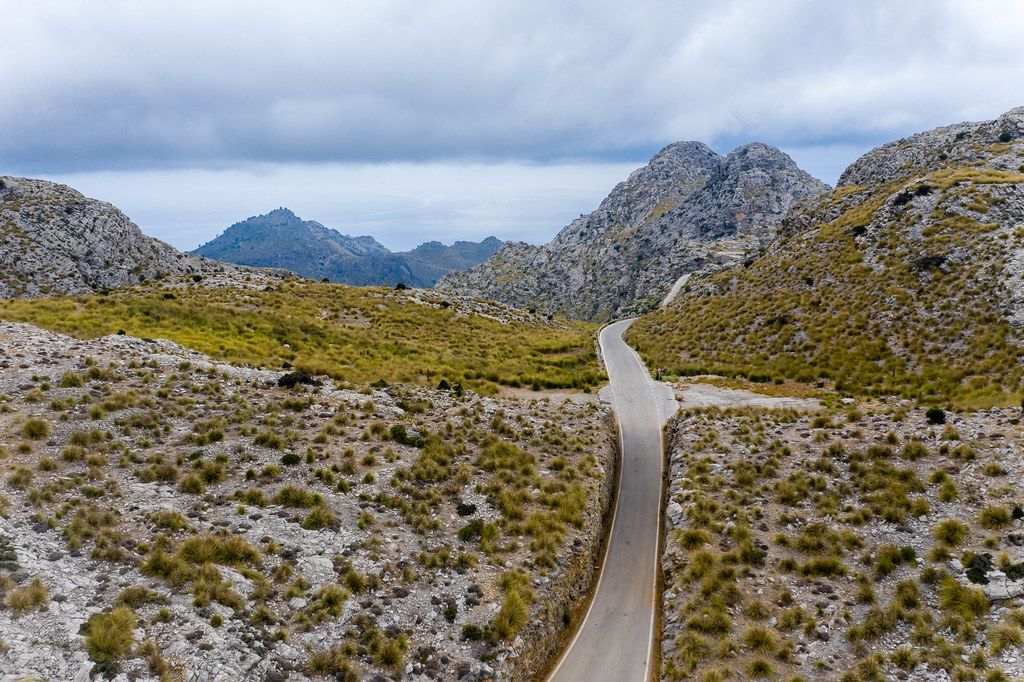 Empty road across rocky mountains: drone photo of Carretera de Sa Calobra. A must-see on Mallorca