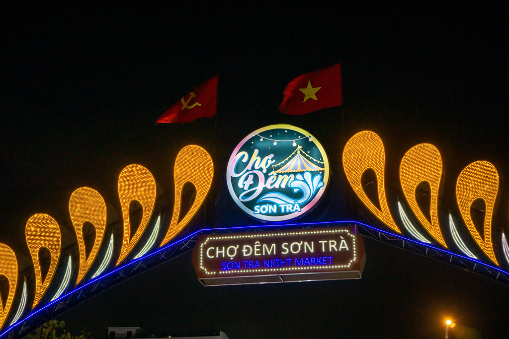 Entrance Gate of Son Tra Night Market with LED Waves and Signboard and waving Flags in Da Nang, Vietnam
