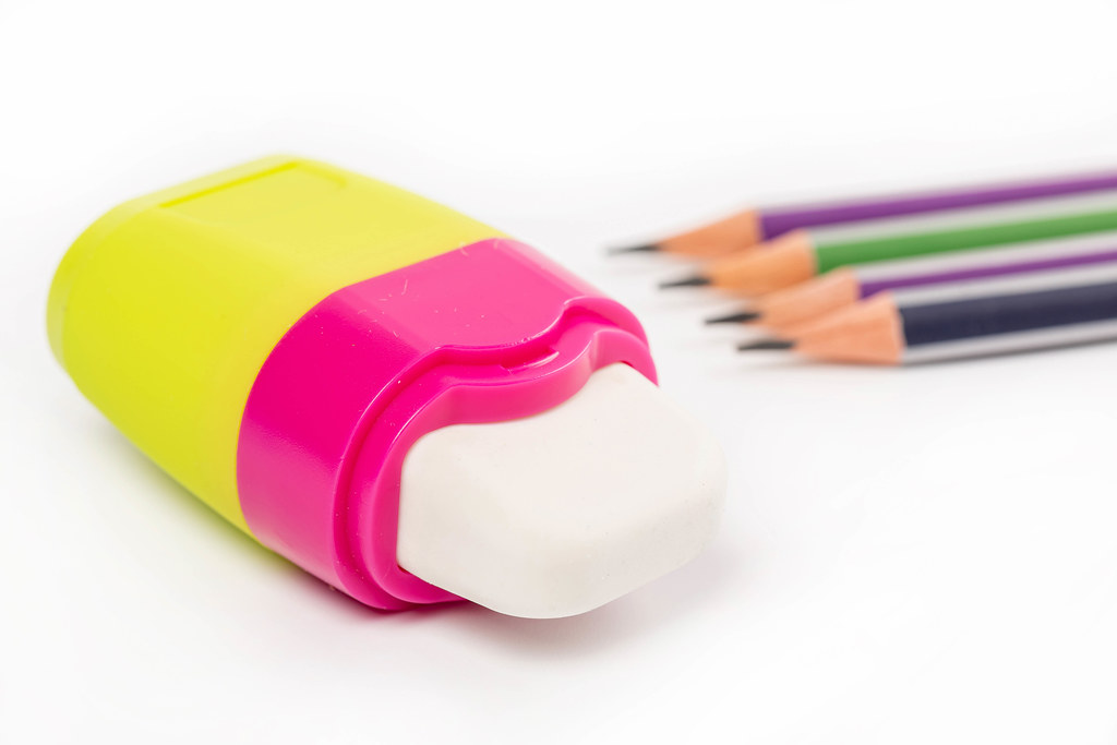 Eraser with simple pencils on white