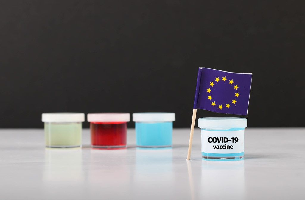 EU flag with Covid-19 vaccine