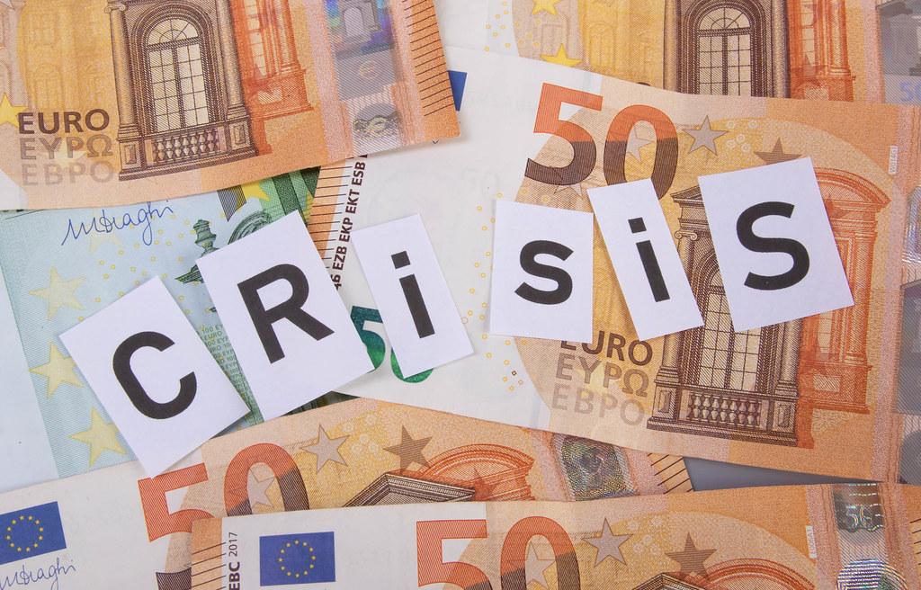 Euro banknotes and Crisis text