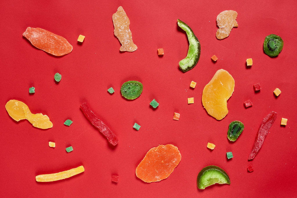 Exotic dried fruits on red background