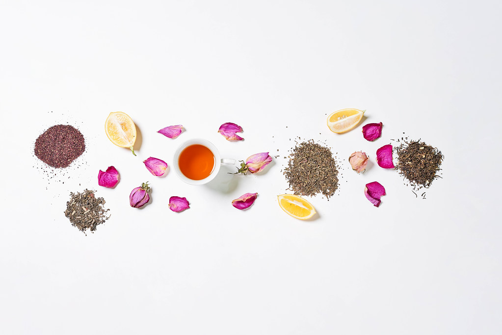 Exotic tea with flower petals and lemon slices
