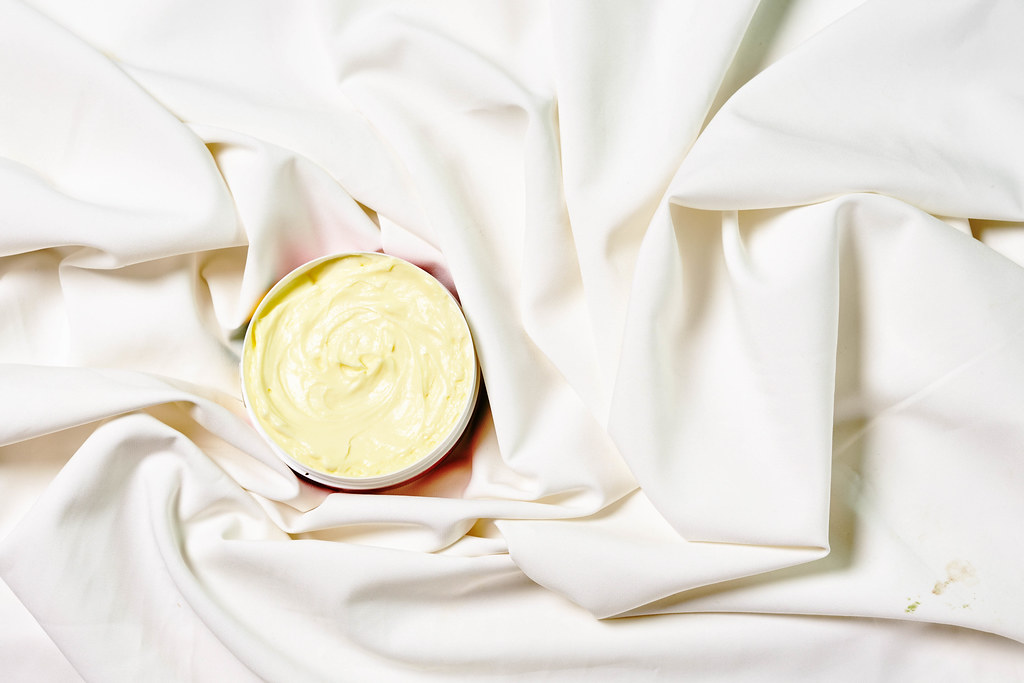 Face cream moisturizer for sensitive skin on white silk fabric