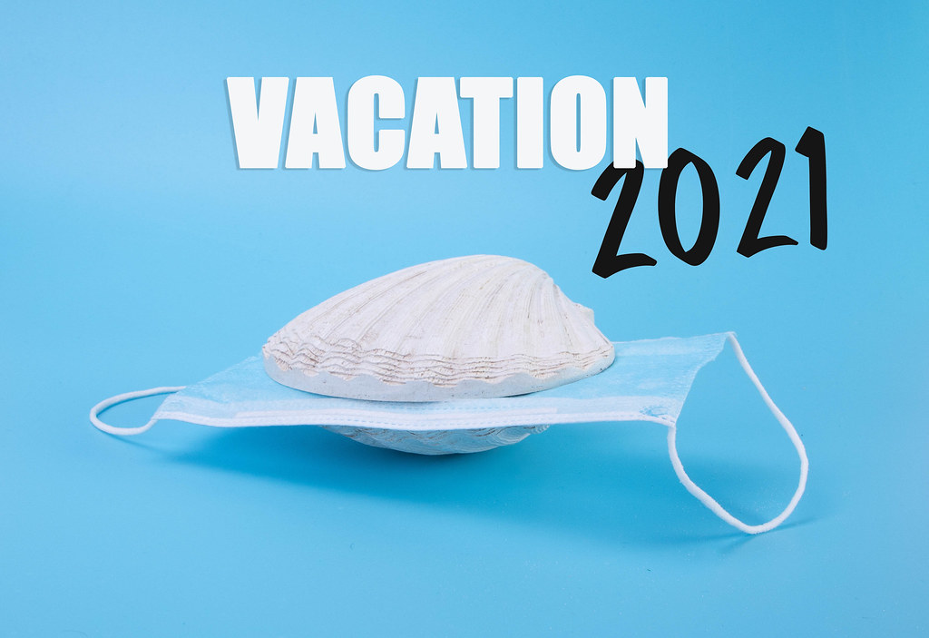 Face mask inside sea shell and Vacation 2021 text