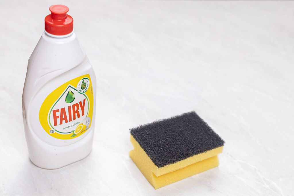 Fairy detergent bottle with Dish Sponge with copy space