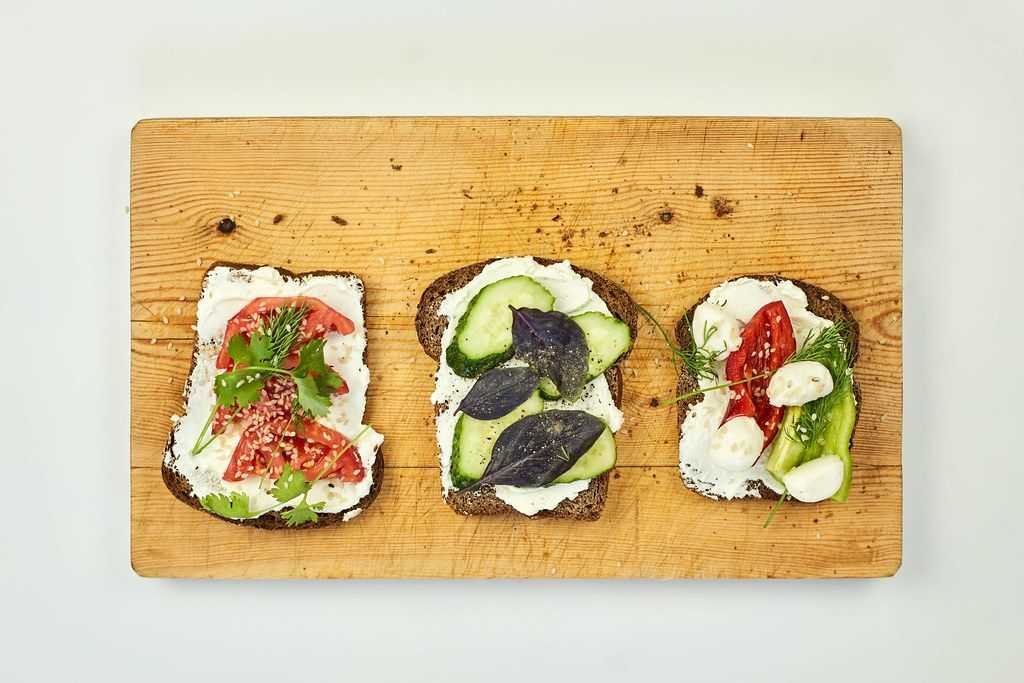 Fast snacks on wooden cutting board