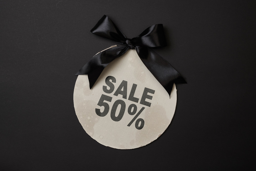 Fifty percent discount. 50 % sale banner with black banner