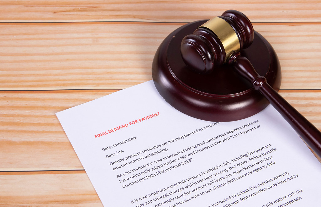 Final Demand for Payment document with a wooden judge gavel