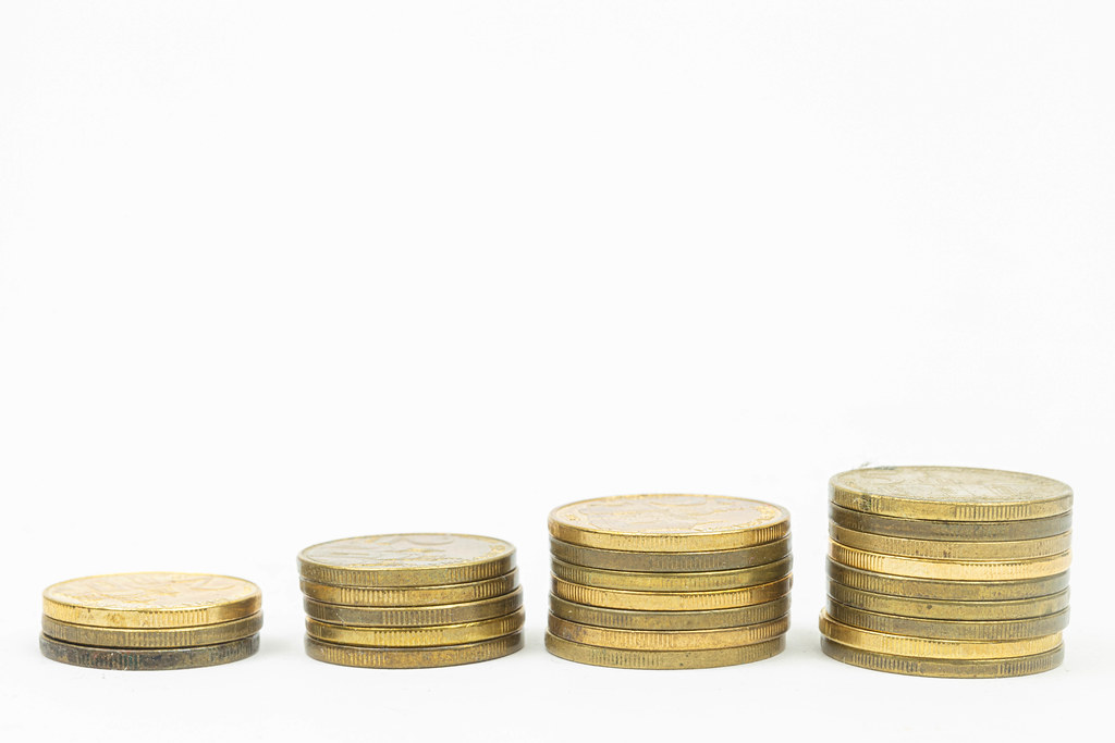 Finance concept image with stairs made of coins with copy space above white background