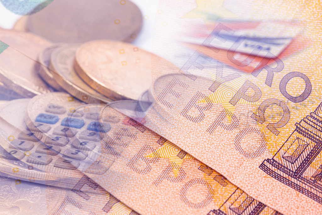 Finance concept with Euro currency and coins in the background