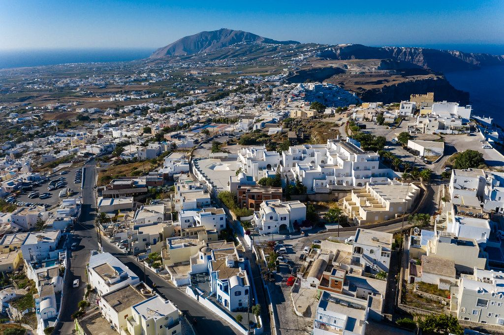 Firá, capital of Greek island Santorini, seen from above with white-washed houses and volcanic cliffs