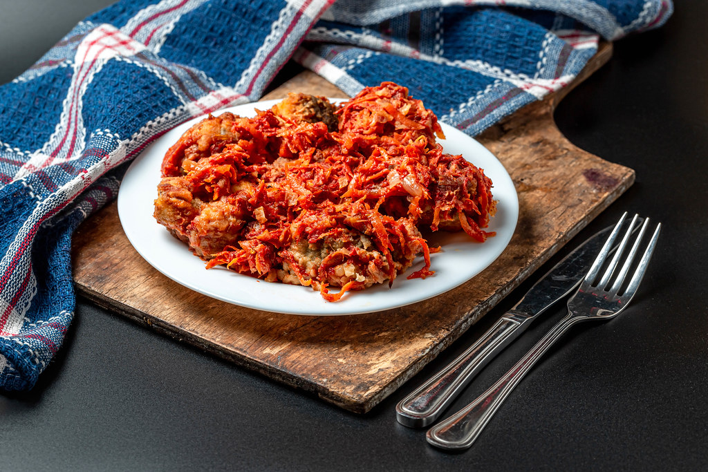 Fish slices in tomato sauce with vegetables