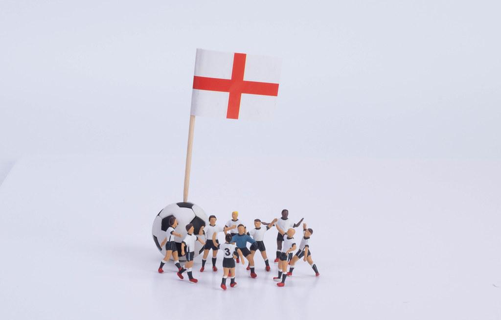 Flag of England and group of football players