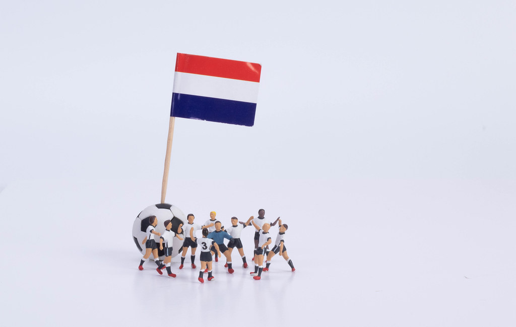 Flag of Netherlands and group of football players