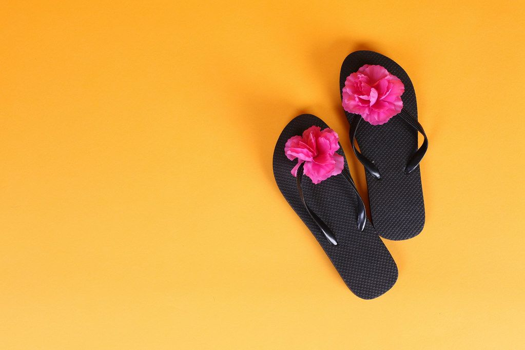 Flip Flops with flowers on orange background