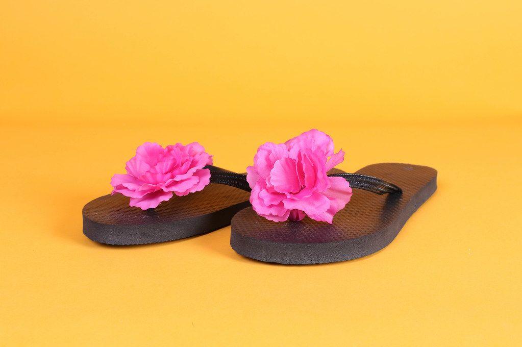 Flip Flops with pink flowers on orange background