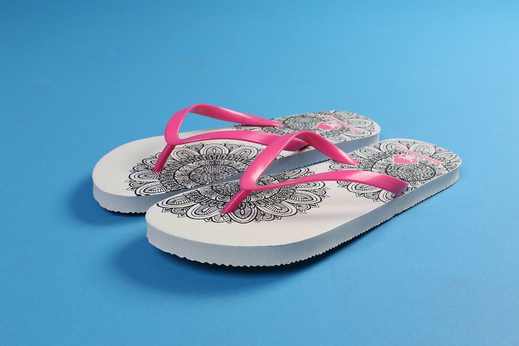 Flipflops on blue background