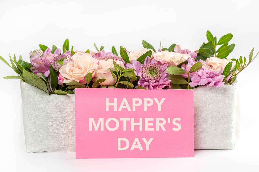 Flowers bouquet with happy mothers day card