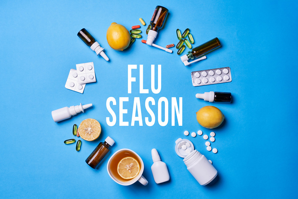 Flue season background with medical supplies and healthy fruits