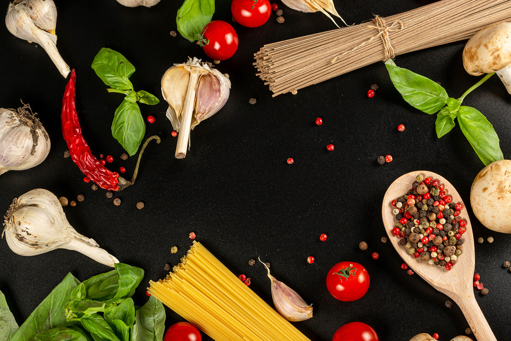Food background with ingredients for cooking spaghetti or noodles