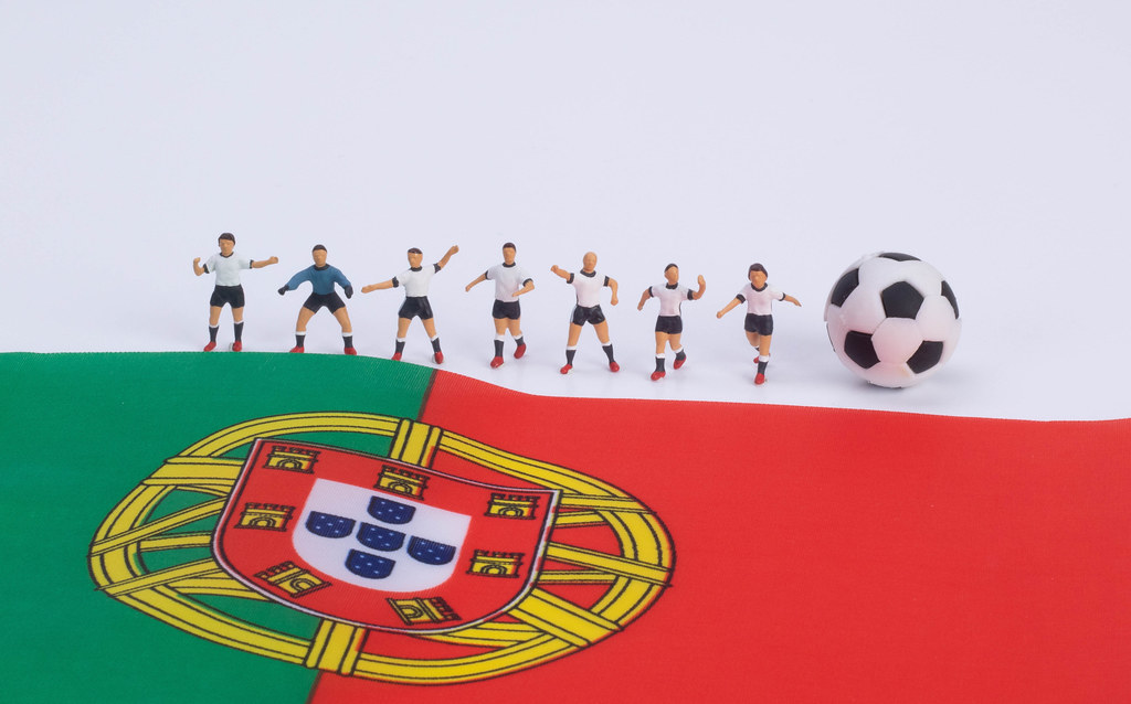 Football players and flag of  Portugal