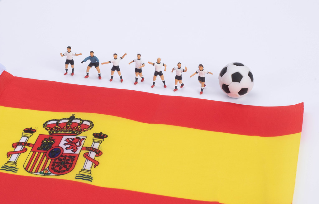 Football players and flag of Spain