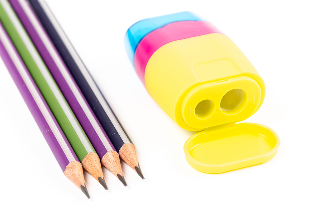 Four pencils and a multi-colored sharpener