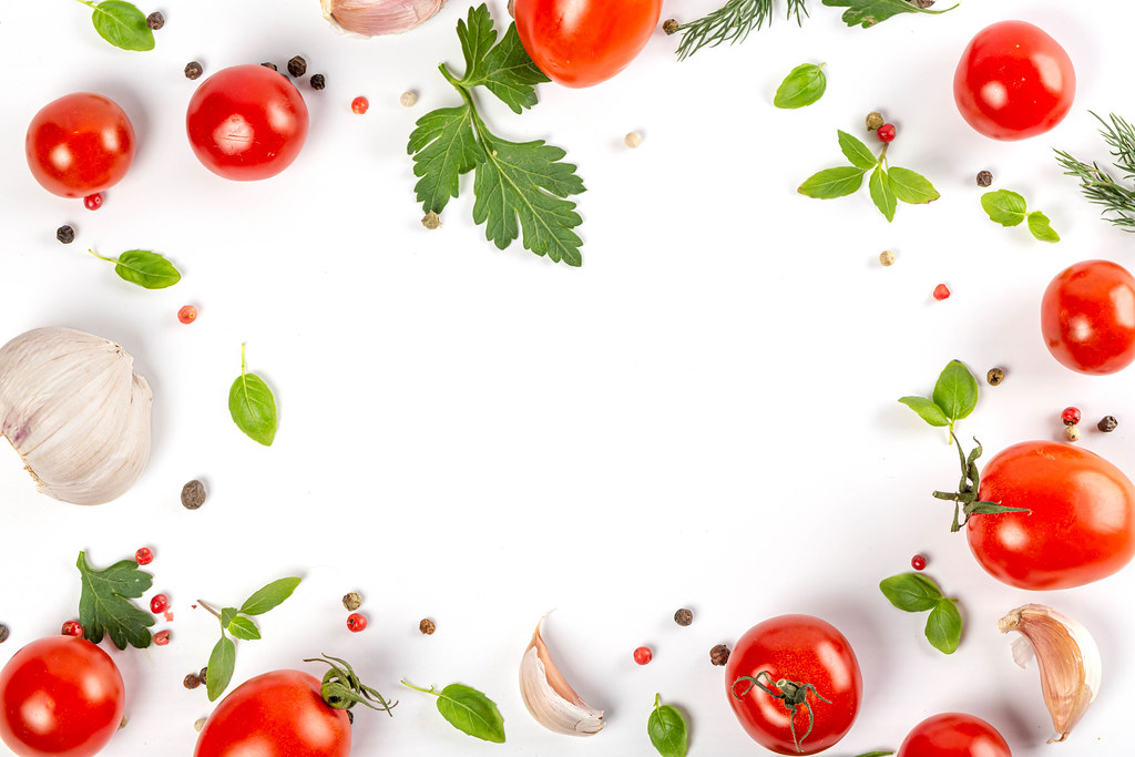 Frame with fresh cherry tomatoes with herbs and spices, top view