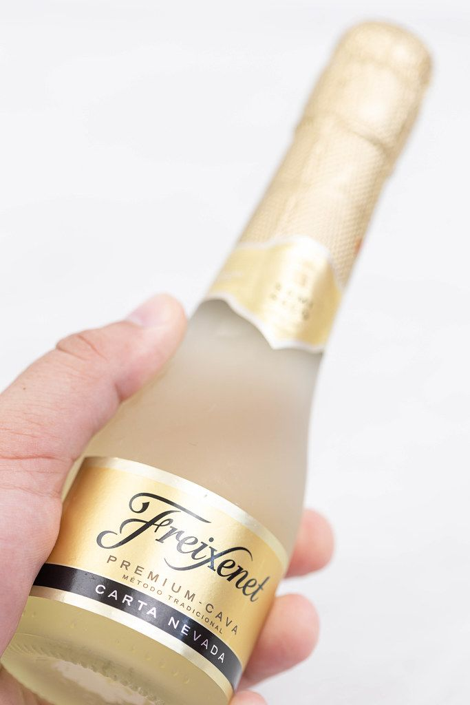 Freixenet bottle in the hand with copy space