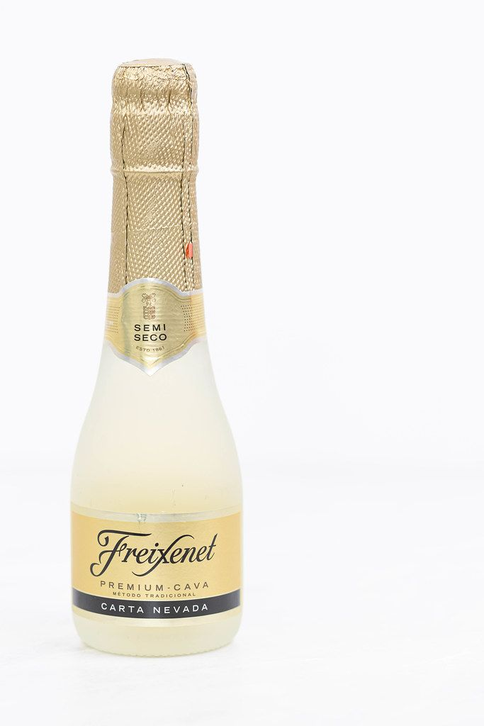 Freixenet bottle vine isolated above white background