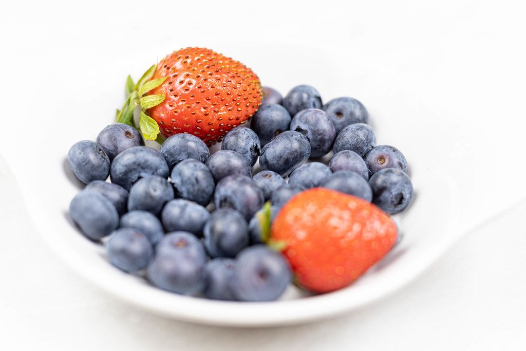 Fresh Blueberries and Strawberries served in the bowl