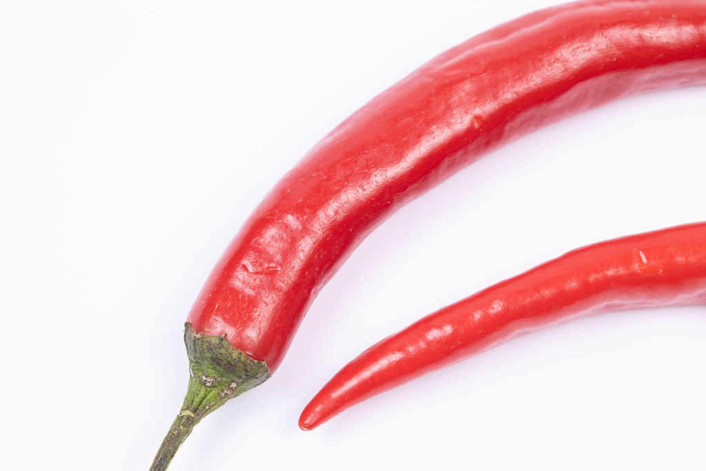 Fresh Chilly Red Hot Peppers above white background