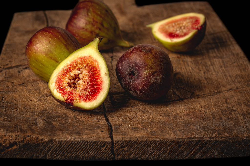 Fresh figs on an old wooden background