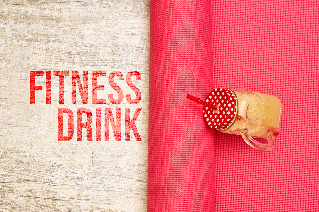 Fresh fitness drink smoothie on yoga mat