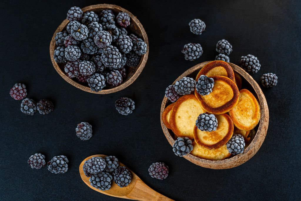 Fresh fried pancakes with blackberries