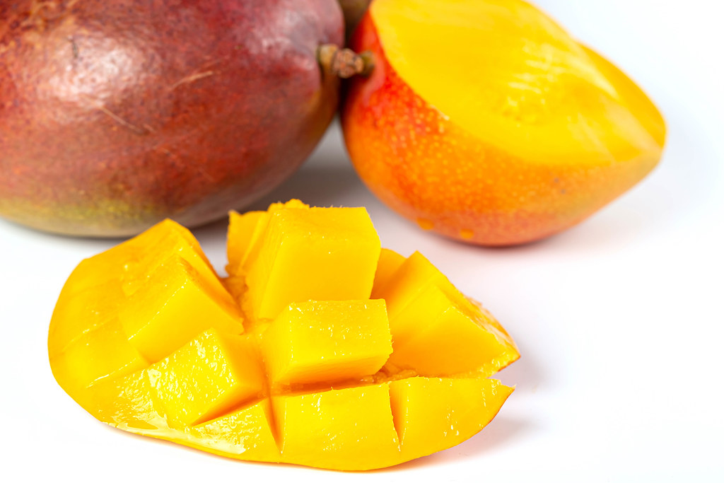 Fresh mango fruits on white background