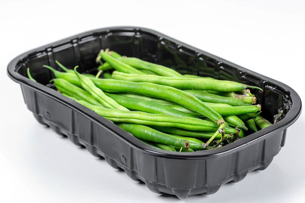 Fresh raw asparagus beans in a black container