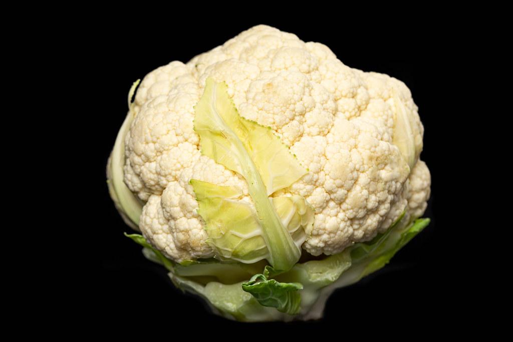 Fresh raw cauliflower on a dark background