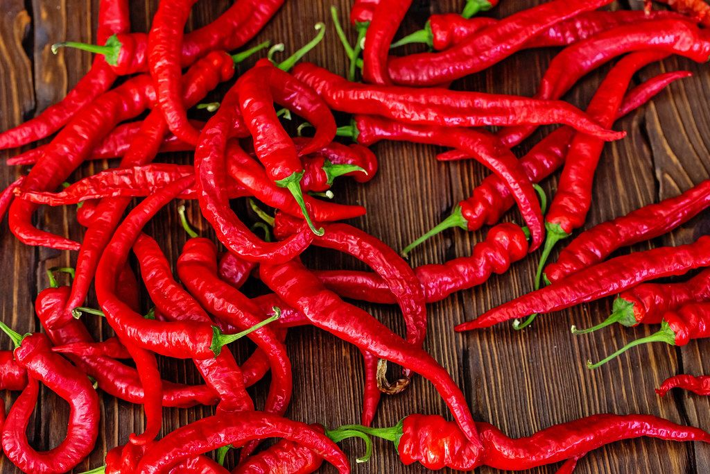 Fresh red chili pepper background