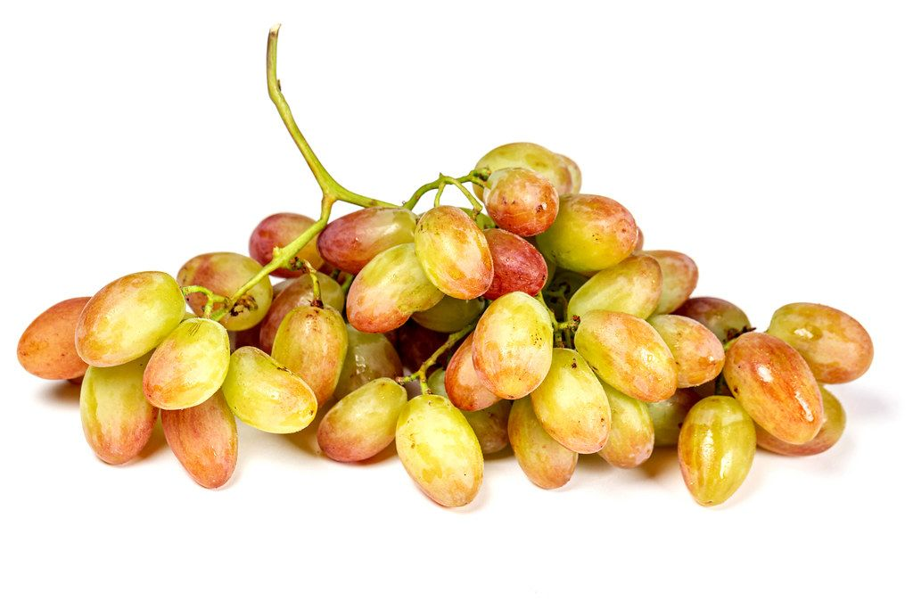 Fresh ripe branch of grapes on white
