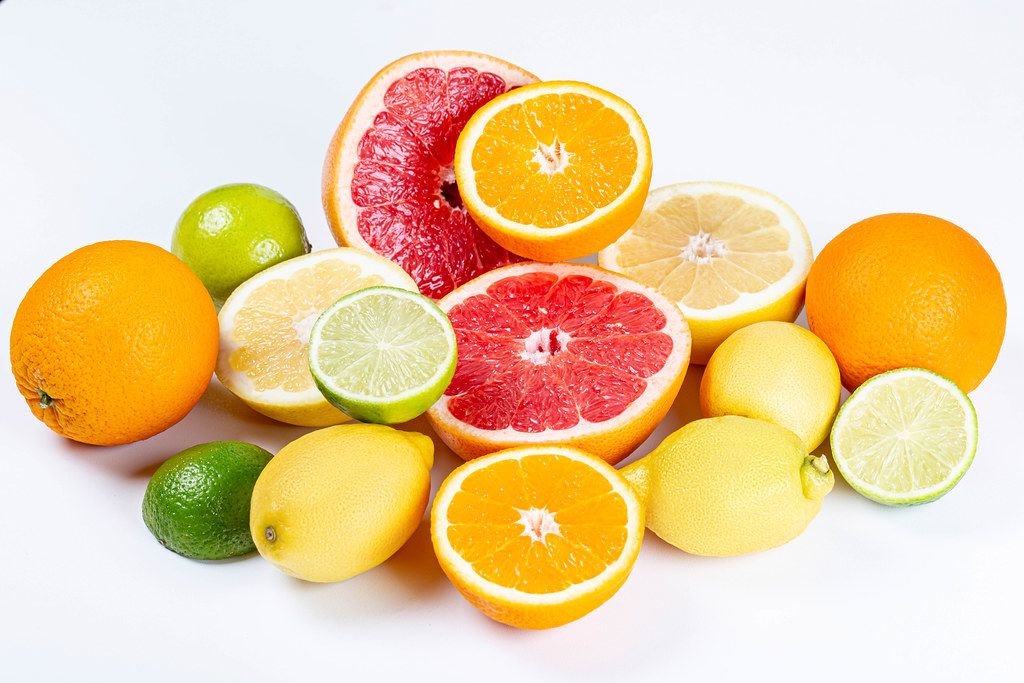 Fresh ripe lemons, oranges, grapefruits and limes on a white background
