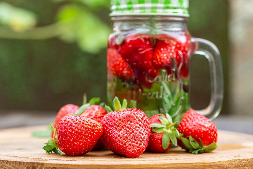 Fresh ripe strawberries and strawberry drink