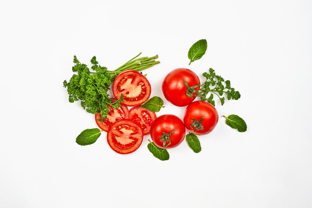 Fresh ripe tomatoes on white background