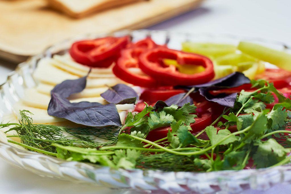 Fresh salad with organic raw vegetables. Close-up shot