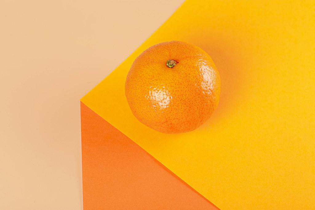 Fresh tangerine on orange background