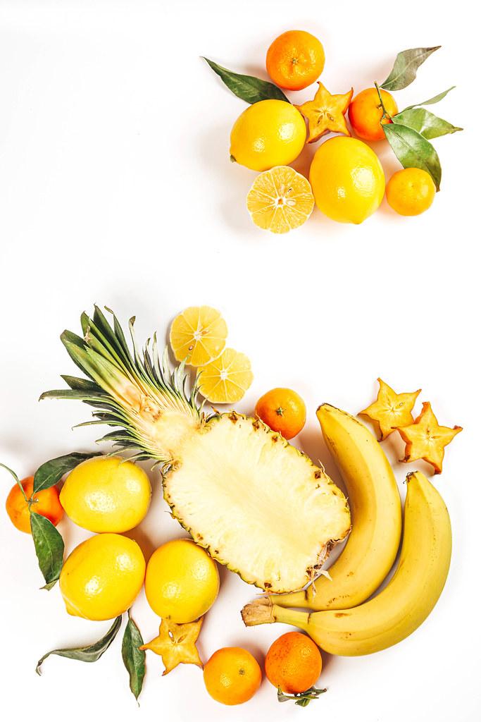 Fresh tropical fruits on white background