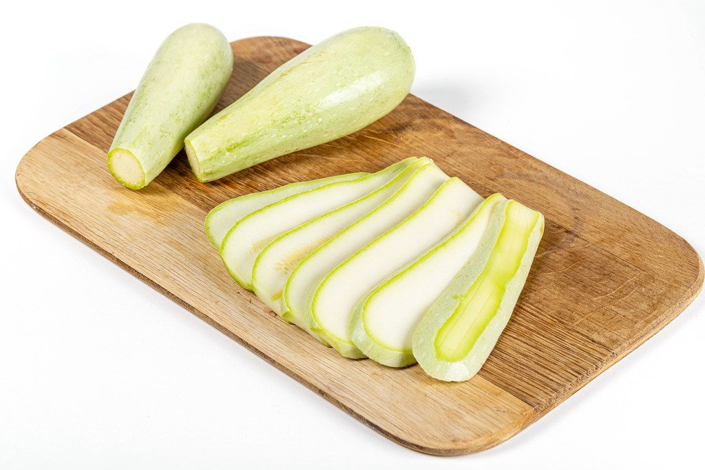 Fresh zucchini on a wooden kitchen board