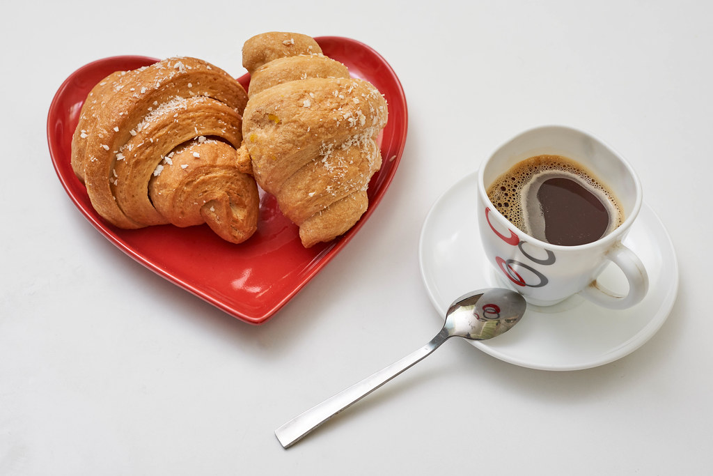 Freshly baked croissants and a mug of black coffee